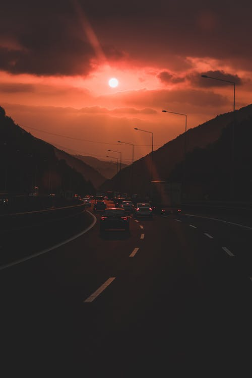 Vehicles  On The  Highway During Golden Hour