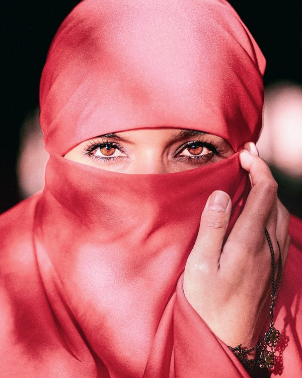 Selective Focus Photography Of Woman Wearing Red Hijab