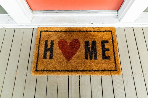 Brown Home-printed Rug Beside Door