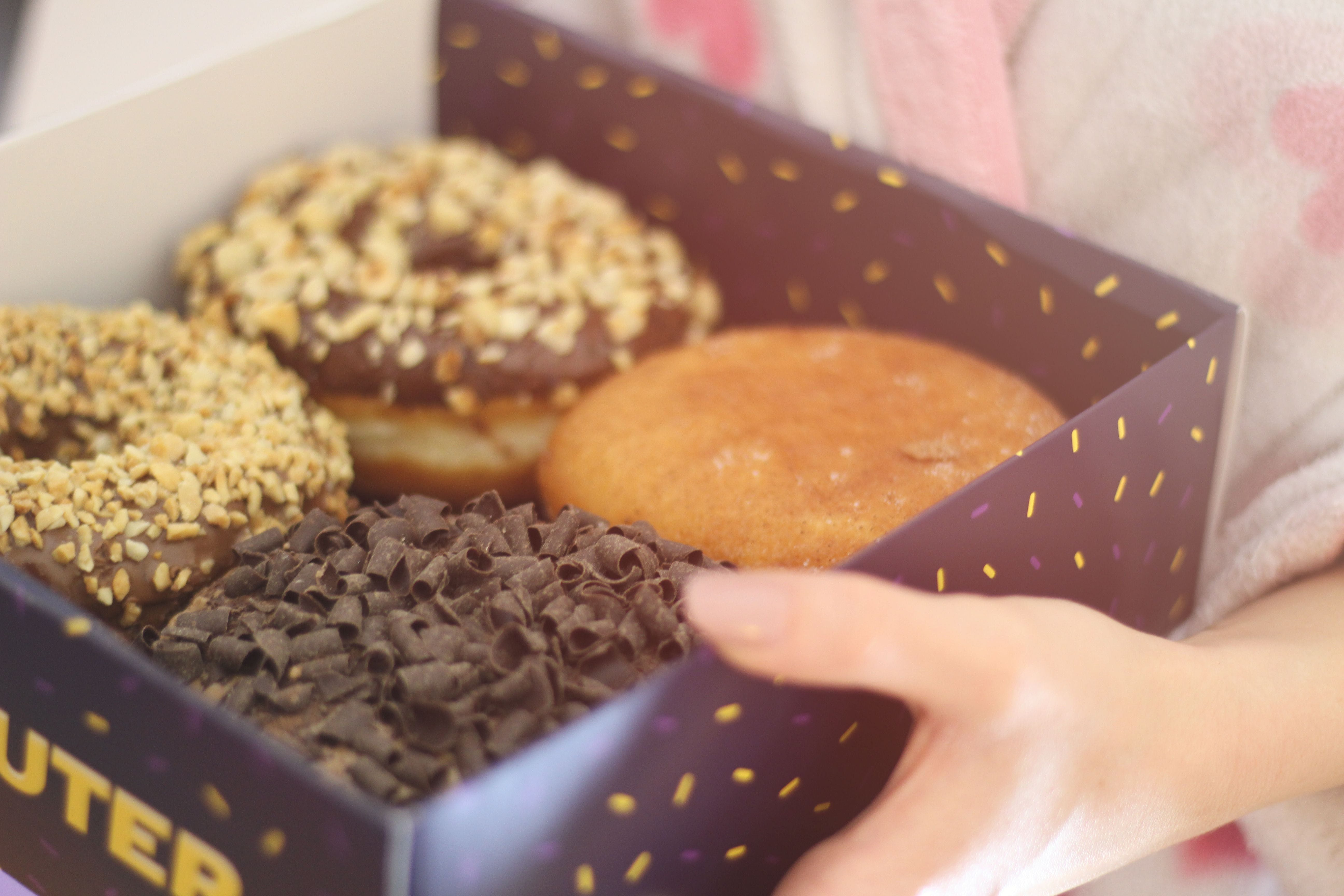 Person Holding Box of Donuts