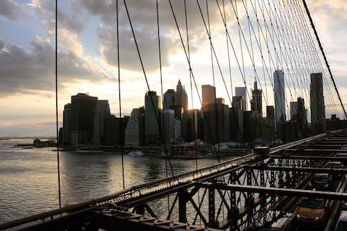 Ingyenes stockfotó Aranyló nap, brooklyn, Brooklyn híd, esti ég témában