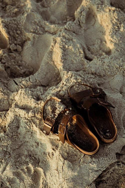 Brown Sandals On Sand