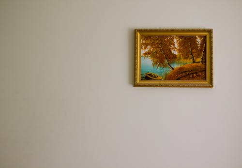 A Single Gold Framed Painting On The Wall