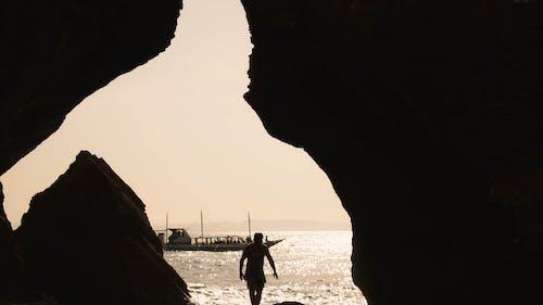Бесплатное стоковое фото с остров, пещера, путешествия фотография, силуэт