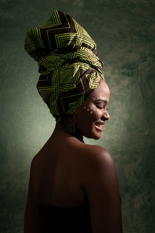 Smiling Woman Wearing Green and Black Turban