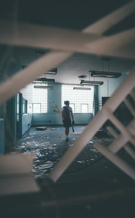 Person Inside A Abandoned Building