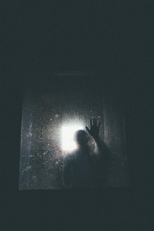 Person Behind Glass Door