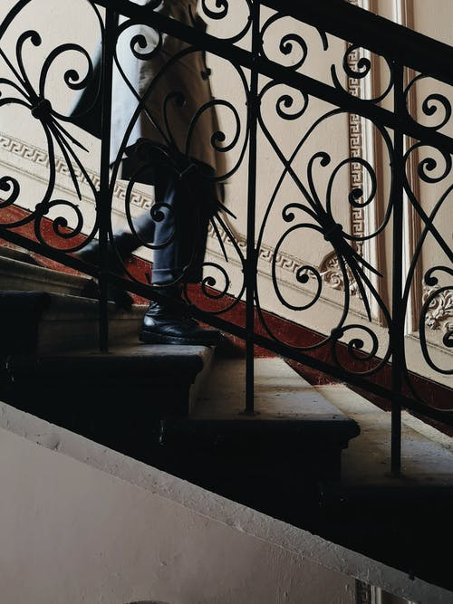 Photo Of Man Using The Stairs