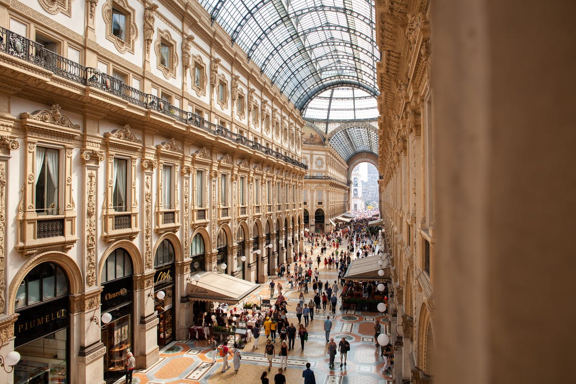 People Inside Galleria Vittorio Emanuele II Shopping Mall In Italy