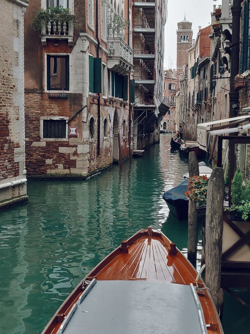 Brown Boat Along The Canals Of Venice