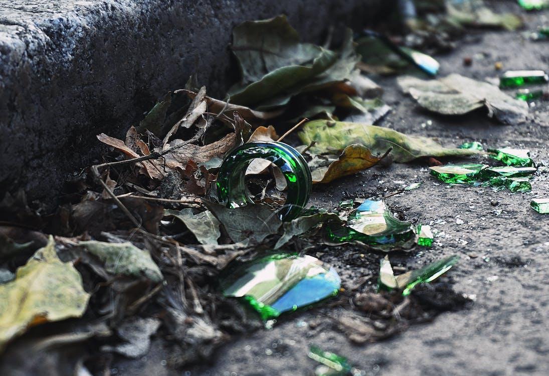 Broken Glass Bottle On The Sidewalk