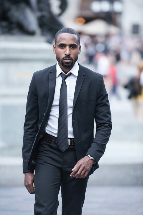Man Wearing Black Suit