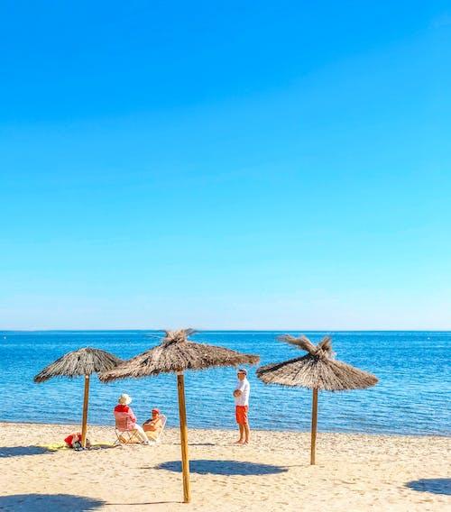 deniz, insanlar, plaj, tatil içeren Ücretsiz stok fotoğraf