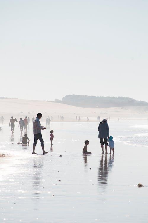 Tourists enjoying vacation on sandy coast