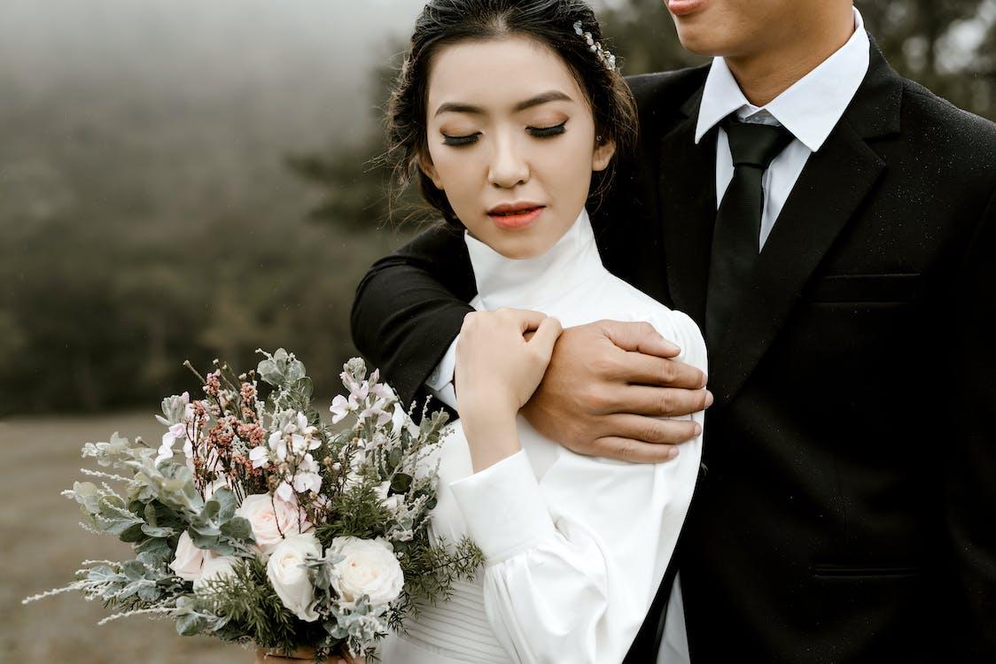 Woman Wearing White Long Sleeved Dress Beside Man