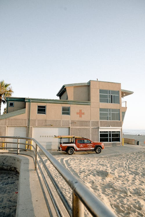 Red Pickup Truck Parked Outside Lifeguard Station