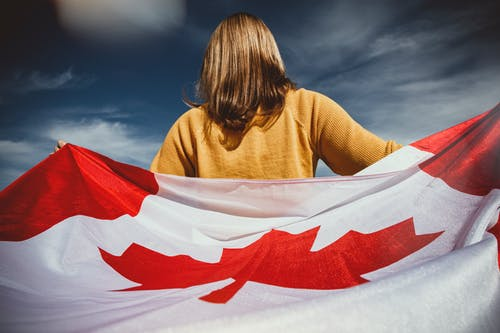 Woman Holding Canada Flag