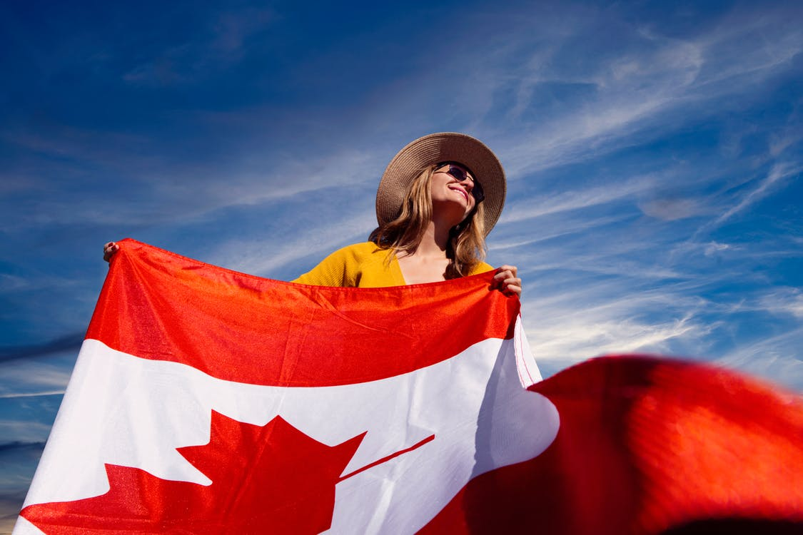 A Photograph of a Woman Holding a Canadian Flag