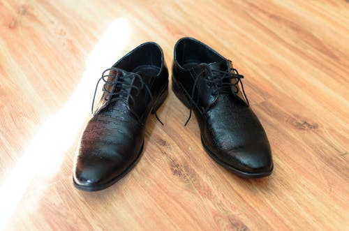 Black Leather Shoes on Flooring