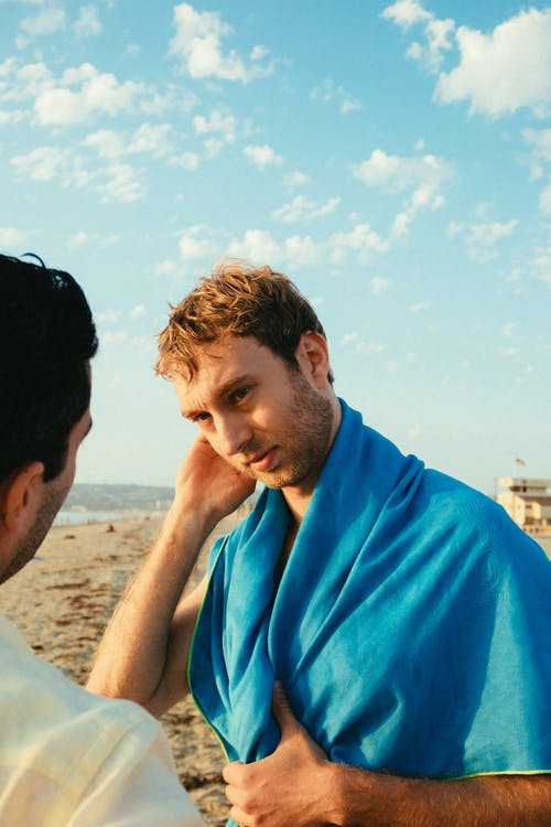 Photo Of Man Wearing Blue Towel
