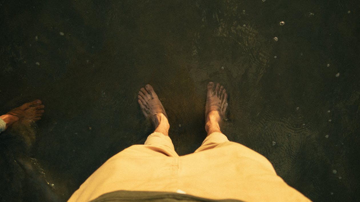 High-Angle Photo of Person's Feet