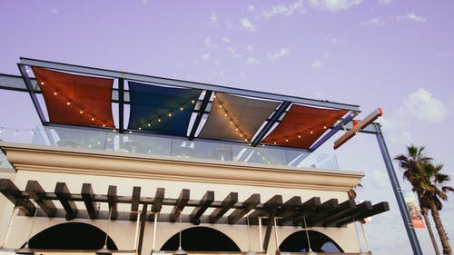White Painted Building With Multicolored Awning