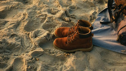 Pair of Brown Work Boots on Sand