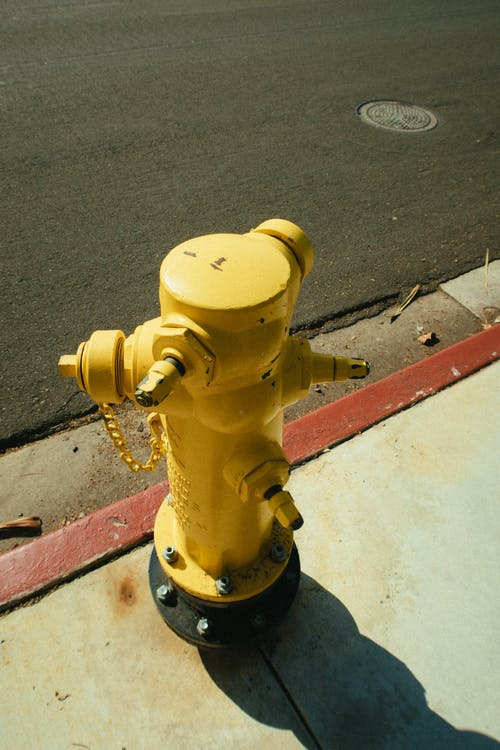 Yellow Fire Hydrant on Street