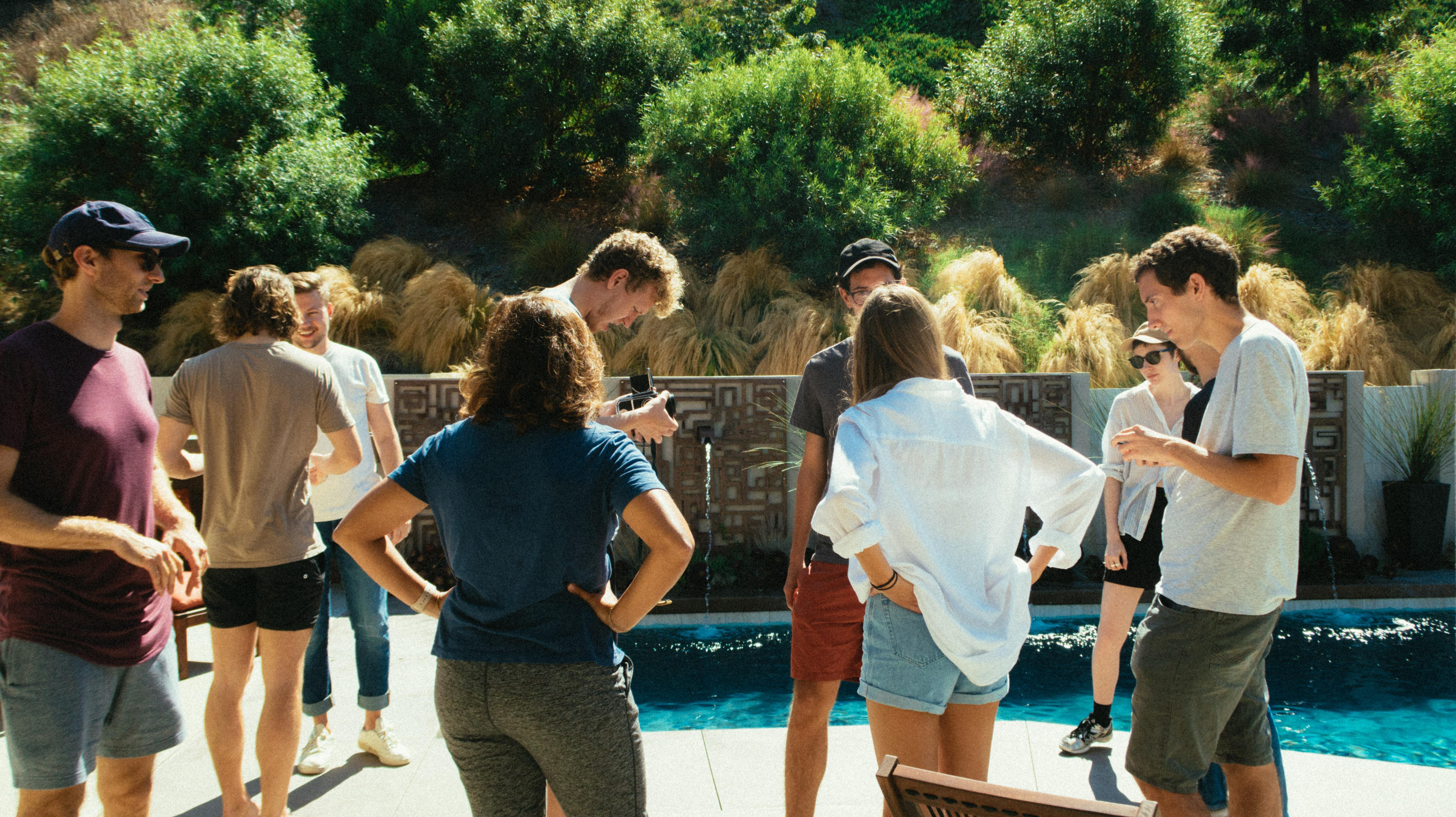 People Standing Beside Pool