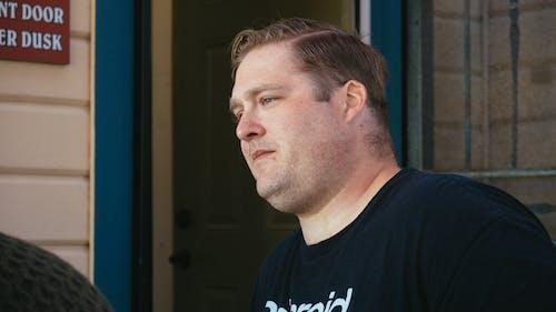 Man Wearing Black Crew Neck Shirt