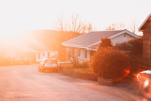 Free stock photo of afternoon, car, houses, light