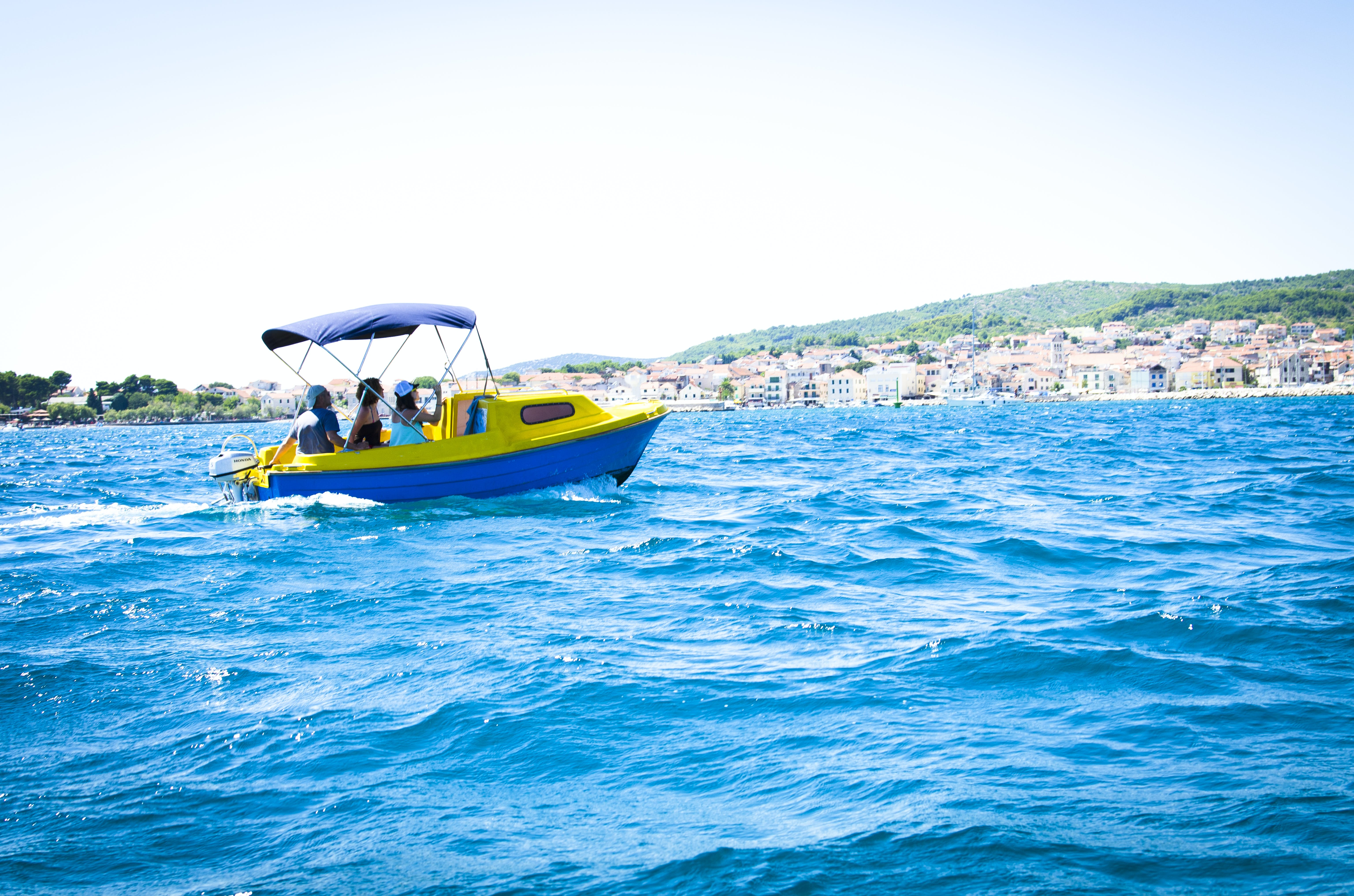 Group of People Riding Bowrider Boat