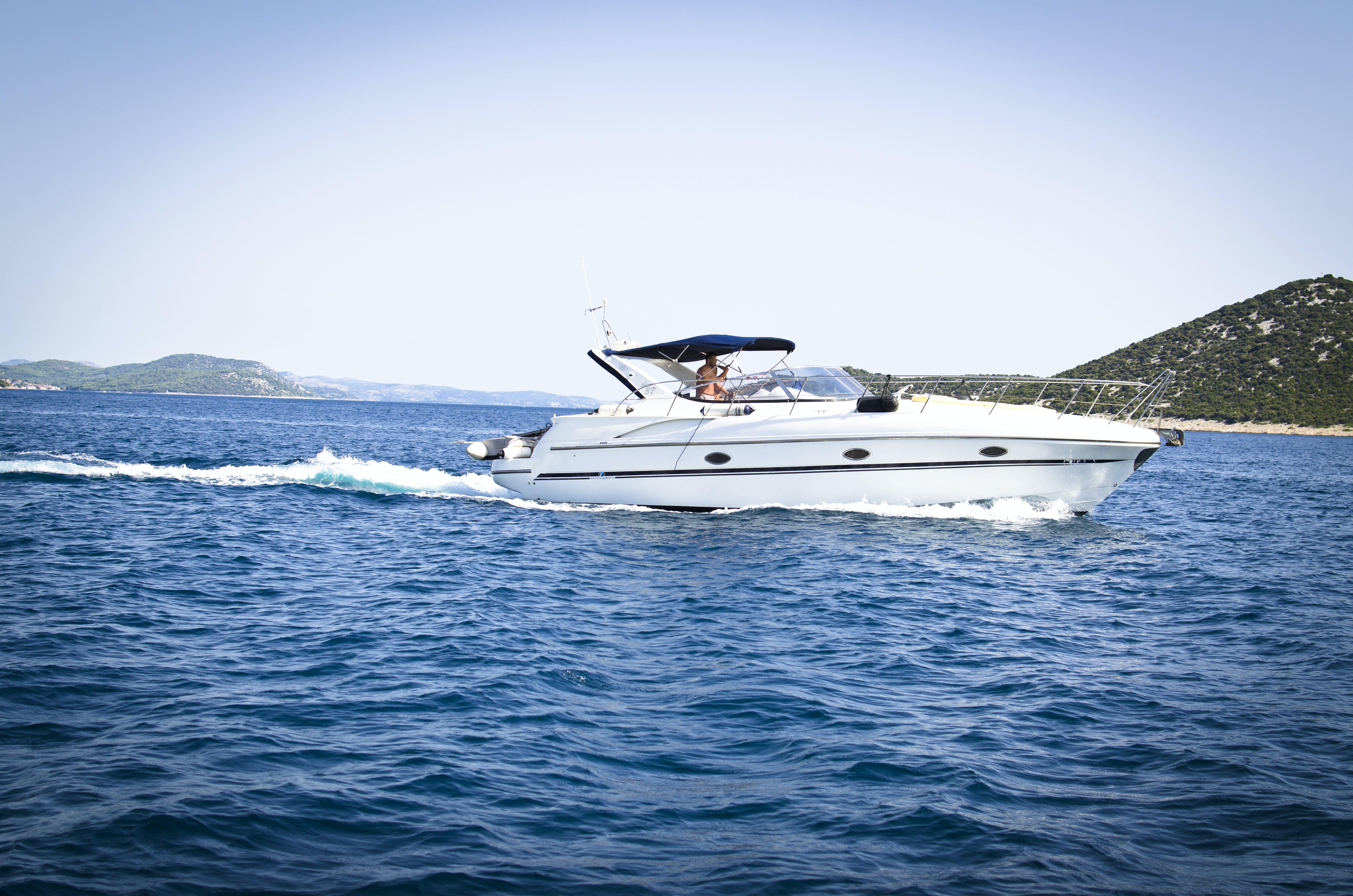 White Speedboat on Body of Water