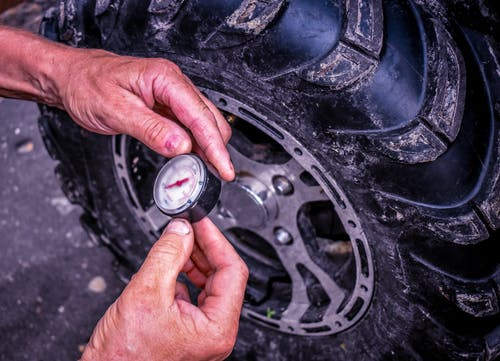 Free stock photo of dirt, hand, measuring, measuring tire pressure
