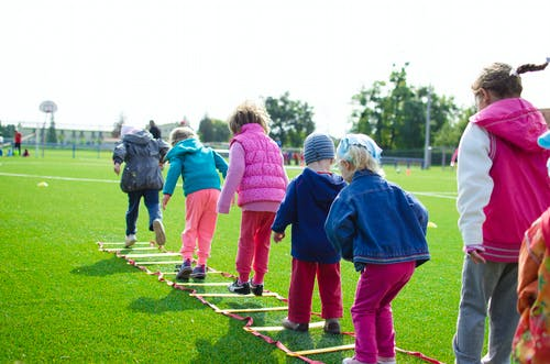 Children's Team Building on Green Grassland