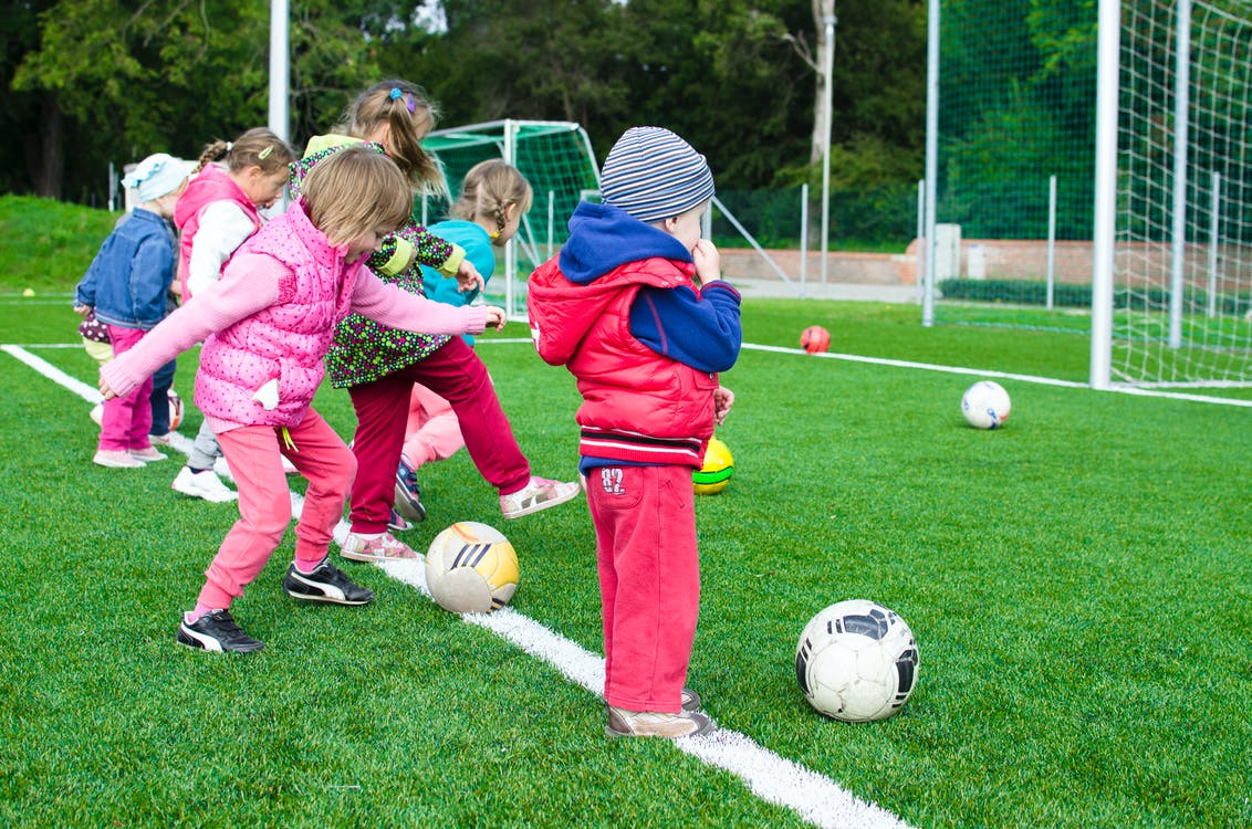 Toddlers being active Playing Soccer, football