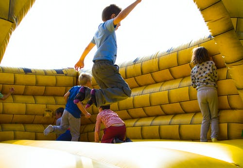 Children Playing on Inflatable Castle