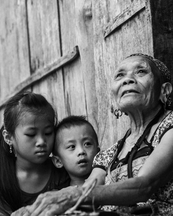 Grayscale Photography Of Woman Beside Children