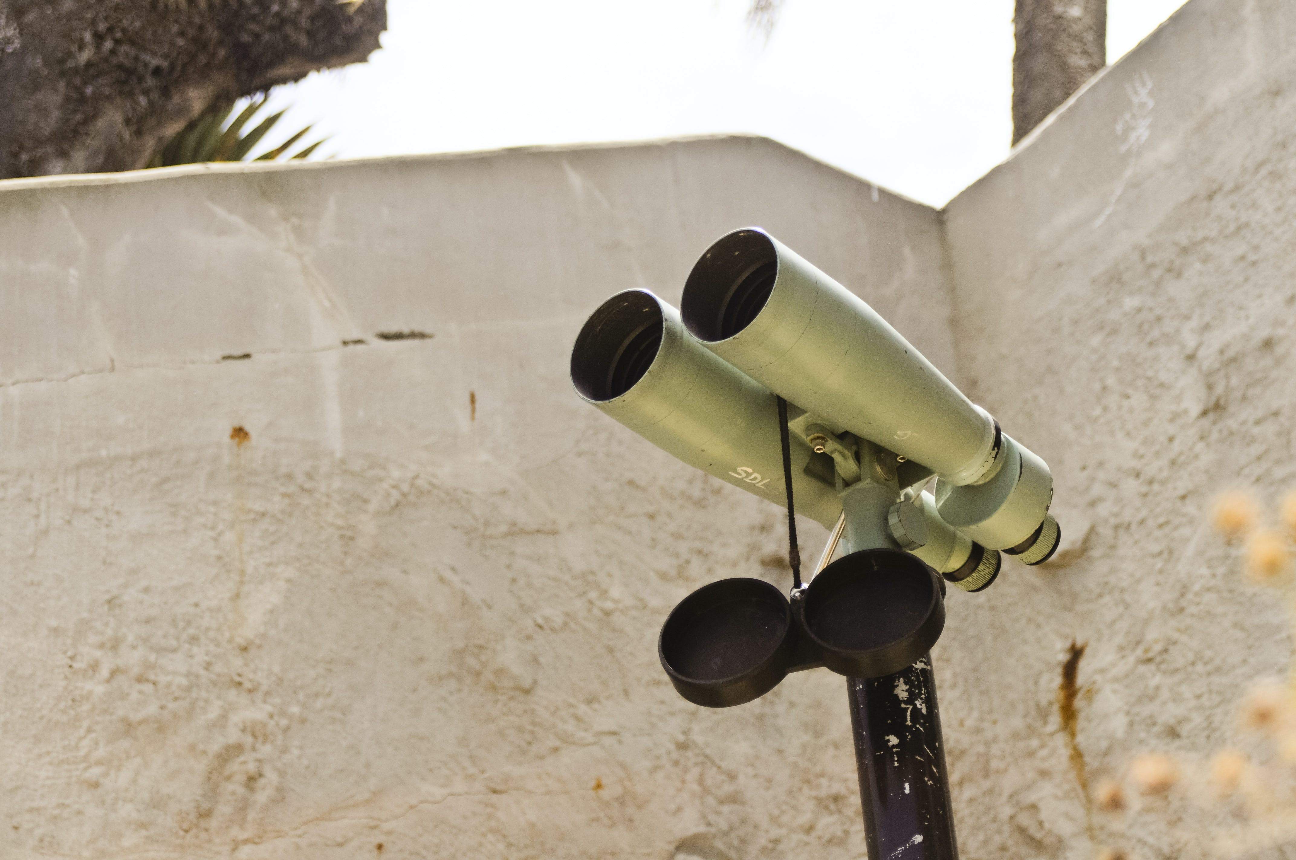 Gray Binocular Scope Near White Wall