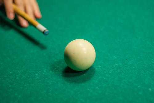 Person Playing Pool\