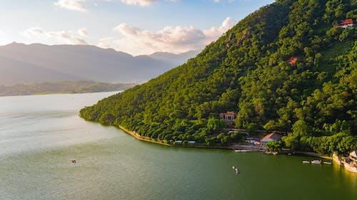 Бесплатное стоковое фото с вода, горы, деревья, за городом