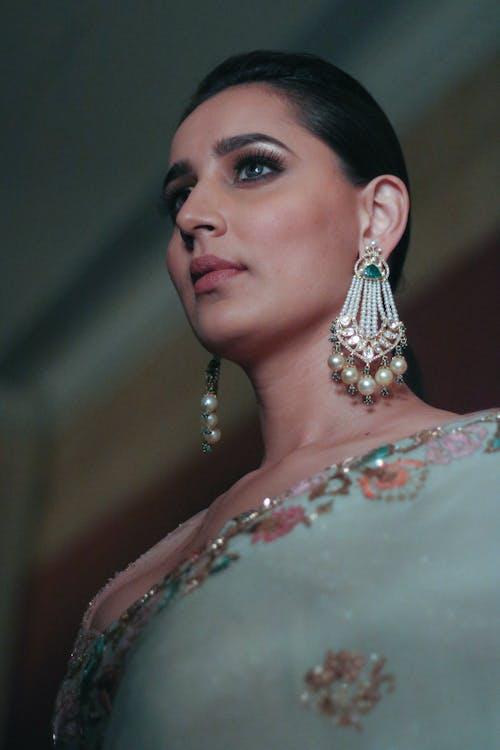 Woman Wearing Silver-Colored White Pearl Chandelier Earrings