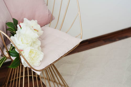 White Flowers On A Chair