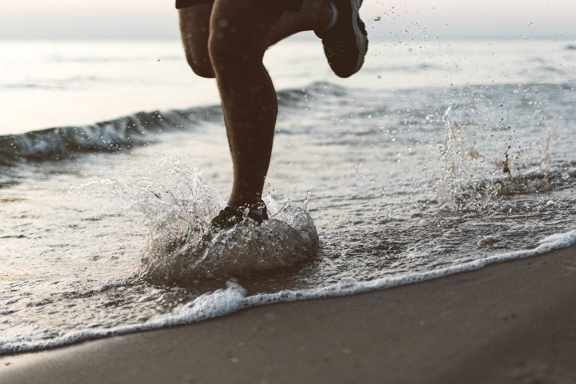 Person Running At The Beach