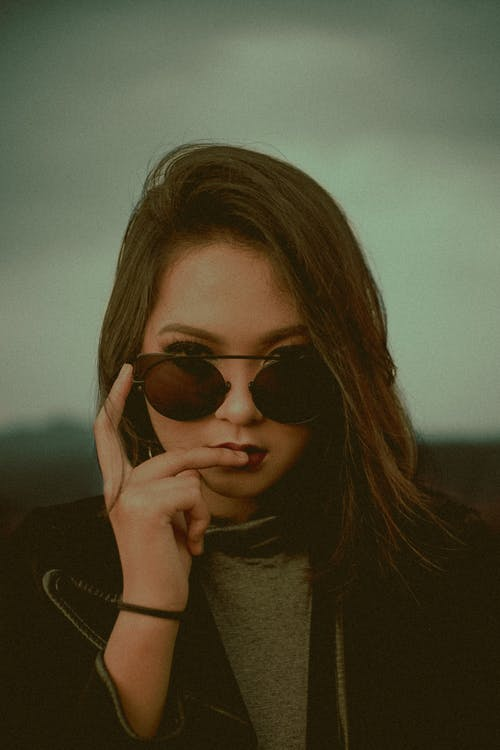 Selective Focus Photography Of Woman Wearing Sunglasses