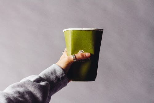 Person Holding Green Cup