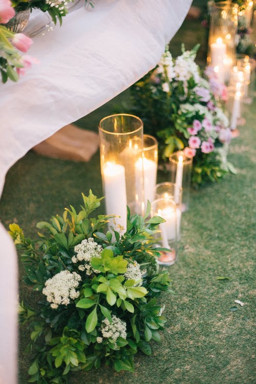 Lighted Candles and Flowers