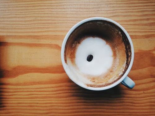 Top View Photo Of Coffee On Top Of Wooden Table