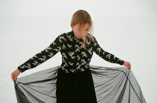 Woman Wearing Black and White Floral Long-sleeved Shirt