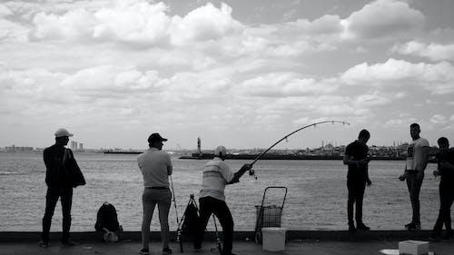 Free stock photo of b&w, elderly, fisherman, fishing rod